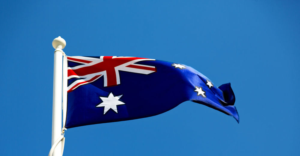 Flag Australia Australian National Background White Symbol Nation Blue Country Sign Day Patriotism Red Textile Wind Travel Freedom Patriotic Silk Banner Tourism Emblem  Texture Design Sky Concept Wave Fabric Pattern Culture Oceania Cross Color Blowing Abstract Isolated Southern Closeup Frame Antique Stars State Union Satin Nationality Flagpole Close Black Pole