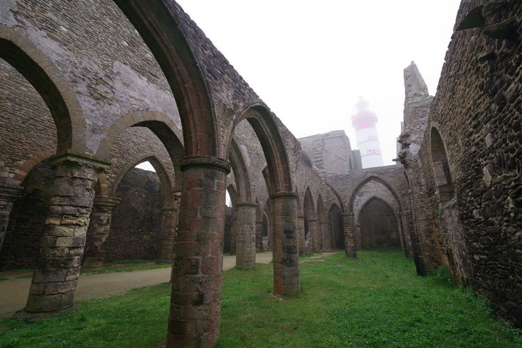 Lighthouse in abbey ruins Brittany Lighthouse St Mathieu Ancient Abbey Architectural Column Foggy Day No People Ruins Architecture