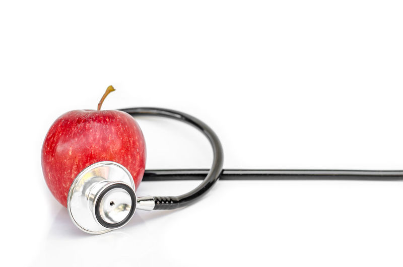 Apple Doctor  Earphones Isolated Close-up Copy Space Cut Out Food Food And Drink Fruit Healthcare And Medicine Healthy Eating Healthy Lifestyle Indoors  Medical Equipment Medical Exam Medical Instrument Medical Supplies No People Red Stethoscope  Studio Shot Wellbeing White Background