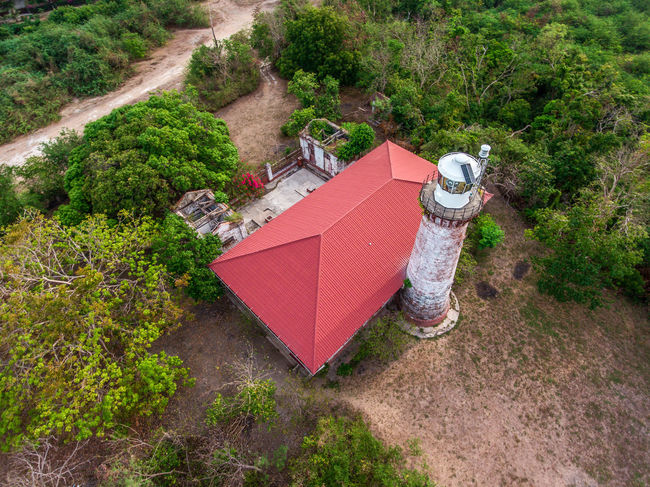 Architecture Beauty In Nature Building Exterior Built Structure Day EyeemPhilippines Grass Growth High Angle View Lighthouse Nature No People Outdoors Plant Tree Water