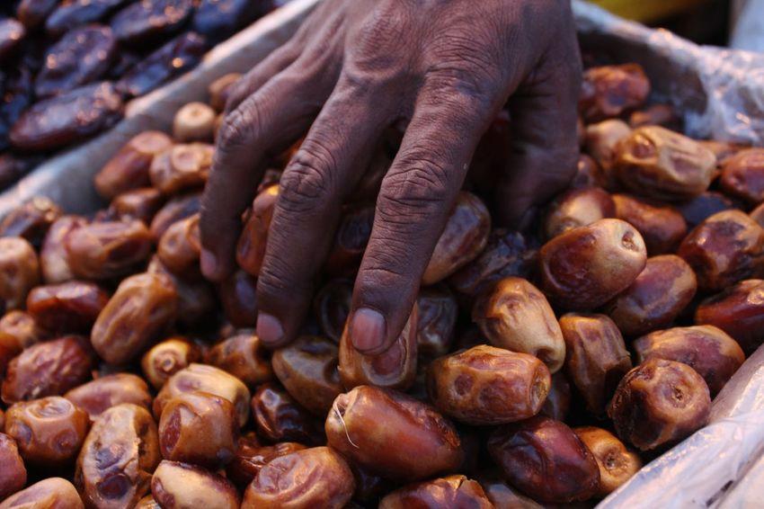 dates fruit Dates Dry Fruits Dates Fruit Dates Palm Human Hand City Market Nut - Food City Street Close-up Street Market Farmer Market