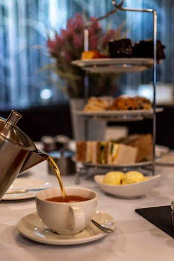 pour yourself into me Marketing Food Hotel Cake Tea And Cake Tea Afternoon Tea Food And Drink Table Freshness Drink Indoors  Food Refreshment Restaurant Focus On Foreground Still Life Saucer Coffee Business Kitchen Utensil No People Crockery Mug Spoon Cup Sweet Food