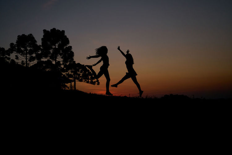 Day Energetic Full Length Landscape Nature Outdoors Real People Silhouette Sky Sunset