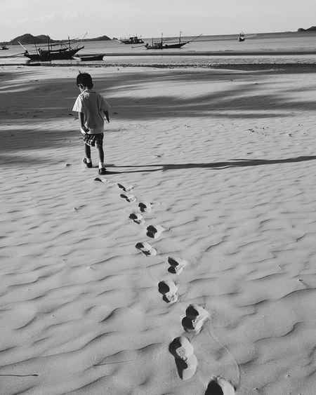 Full Length Sea Beach Water Sand Low Tide Standing Walking FootPrint Sky
