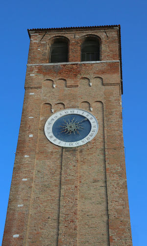 Bell tower with roman numerals in downtown of Chioggia Island near Venice in Italy Ancient Roman Number Architecture Bell Tower Belltower Building Chioggia Clock Clock Tower Clock Towers Italiana Italy Low Angle View Medieval Outdoors Place Of Worship Province Of Venice Religion Roman Numbers Roman Numeral Roman Numerals Tower Tower Clock Vencie Province Venice