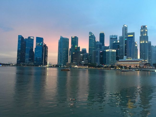 Singapore 🎈👻 Built Structure River Marina Bay Financial Centre Outdoors Outdoor Photography Evening Sunset Sky Skyscraper Landscape Waterfront Urban Skyline Tall - High Modern No People Nature Office Architecture Building Exterior City Financial District  Water Cityscape