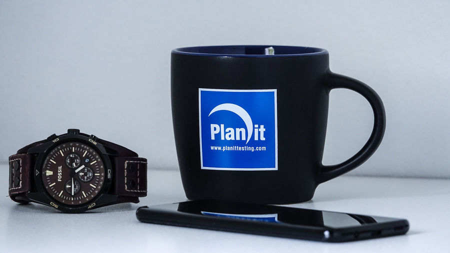Planit Watch Australia Sydney Business Finance And Industry Business Company Software Desk Low Angle View Mug Technology Lifestyles EyeEm Best Shots EyeEm Gallery EyeEmNewHere Indoors  Office Working Job Blackandwhite Blue White Background Drink Studio Shot Text Black Color Close-up Black Coffee Cappuccino Logo