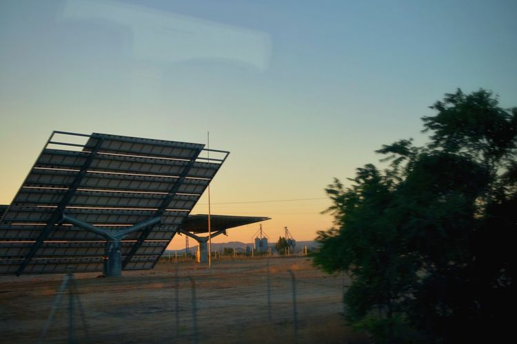 Renewable Energy Environmental Conservation Fuel And Power Generation Growth Environment Alternative Energy Building Exterior Architecture Sunset No People Nature Clear Sky Outdoors Built Structure Reflection Sky Morning Morning Light Solar Panel SPAIN From The Train Window Modern Ecology Ecological Clean Energy Tree