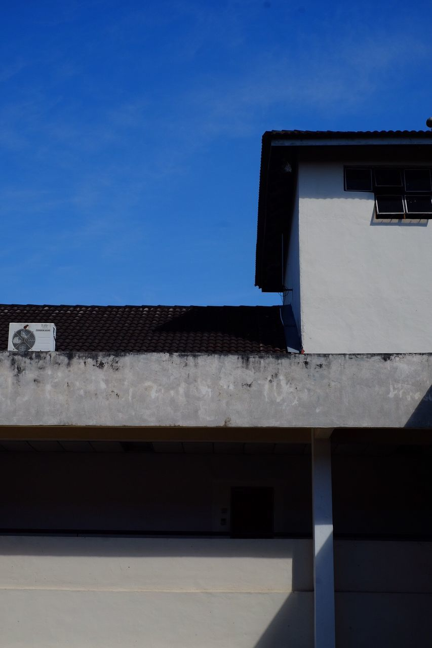 built structure, building exterior, architecture, low angle view, no people, outdoors, day, sky, roof, blue, clear sky