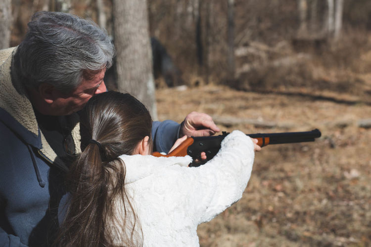 Learning Adult Bonding Childhood Close-up Concentration Day Family Grandparent Guns Leisure Activity Lifestyles Outdoors People Real People Shooting Skill  Teach Togetherness Two People Women