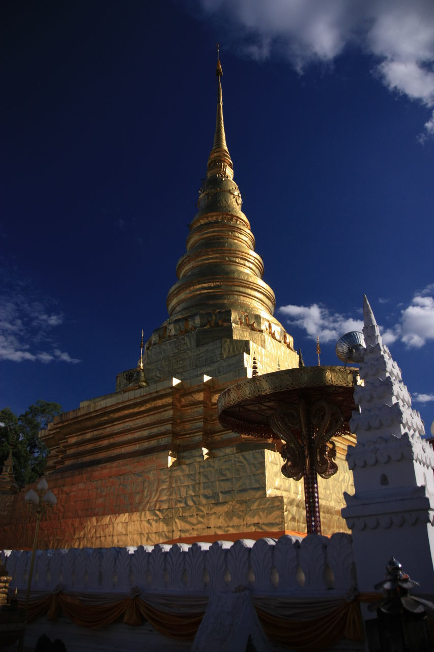 religion, place of worship, spirituality, architecture, sky, building exterior, built structure, pagoda, low angle view, cloud - sky, travel destinations, gold colored, outdoors, day, no people