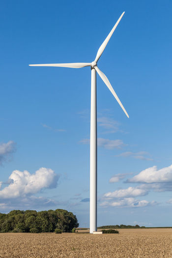 Field Alternative Energy Beauty In Nature Blue Blue Sky Cloud - Sky Day Environmental Conservation Field Fuel And Power Generation Industrial Windmill Landscape Low Angle View Nature No People Outdoors Renewable Energy Rural Scene Sky Technology Wind Power Wind Turbine Windmill