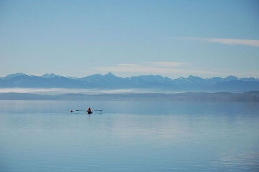 Blue Exploration Mountain Adventure Outdoors Starnberger Sea Mountain Range Scenics Kayak Adults Only Lake People Sky Water Beauty In Nature Landscape Floating On Water Nature Day Vacations