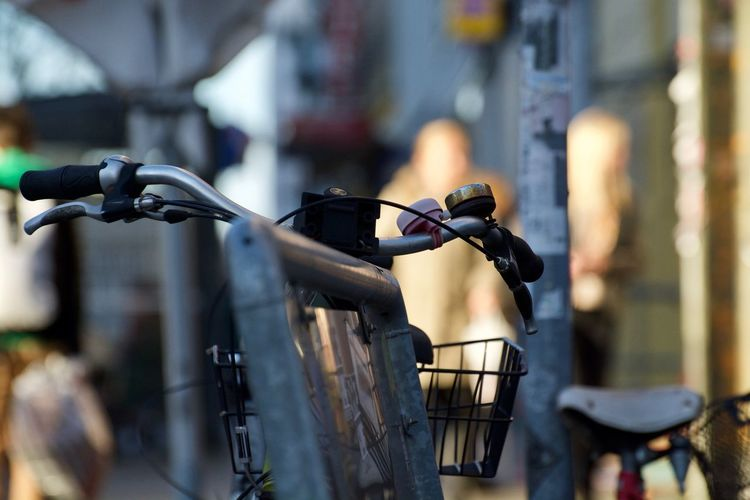 Close-up of bicycle parked on street