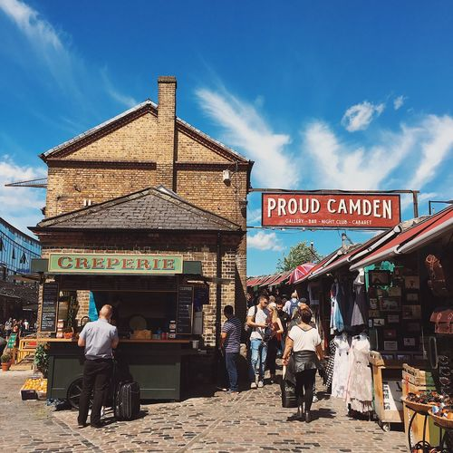 Camden Market Sky Real People Cloud - Sky Day Built Structure Men Architecture Text Outdoors Lifestyles Sunlight Building Exterior Leisure Activity Women Large Group Of People Travel Destinations Sitting Adult People Adults Only Camdenmarket London The Week On EyeEm Investing In Quality Of Life Your Ticket To Europe Postcode Postcards