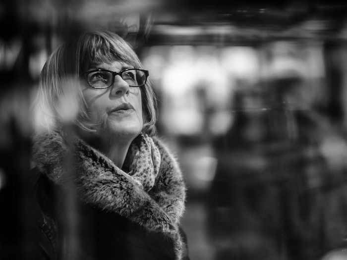 Thoughtful Mature Woman Wearing Scarf Looking Up During Winter