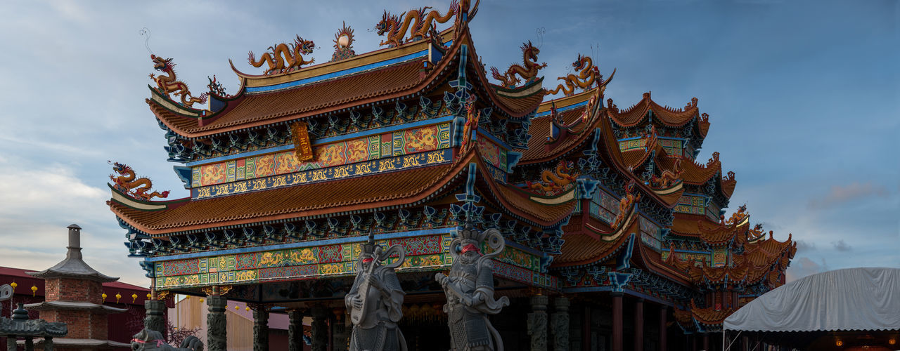 Penang Nine Emperor God Temple Architecture Place Of Worship Building Exterior Built Structure Belief Religion Spirituality Building Sky Roof Low Angle View Cloud - Sky Nature Day No People Travel Destinations Outdoors Eaves Ornate