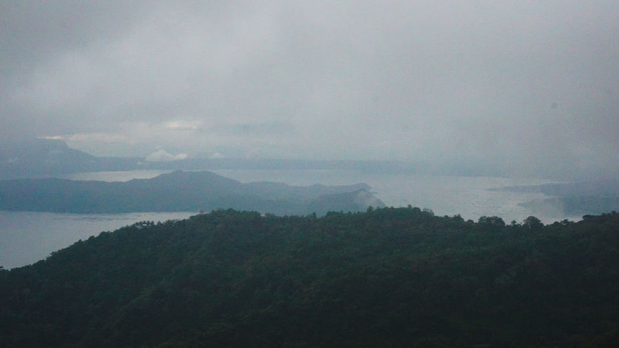 T A A L Foggy Mountains Foggy Weather Taal Volcano Taking Photos Beauty In Nature Cloud - Sky Day Foggy Foggy Day Foggy Landscape Foggy Morning Foggymorning Forest Landscape Mountain Mountain Range Nature No People Outdoors Scenics Sky Tranquil Scene Tranquility Tree Volcano Shades Of Winter