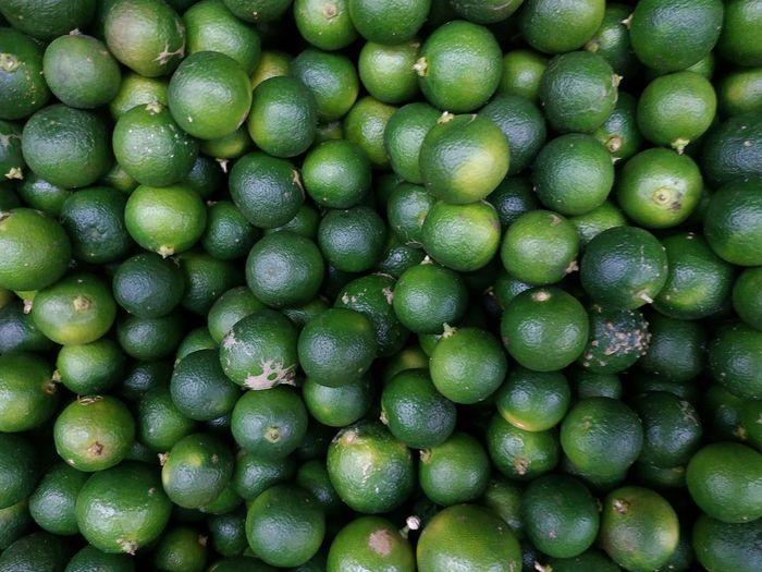 Full frame shot of limes in market for sale