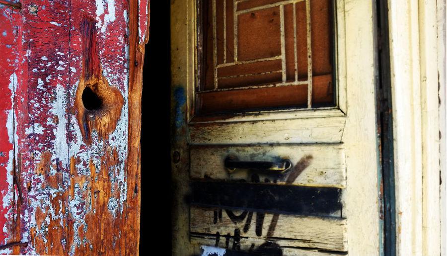 Close-up of weathered open door