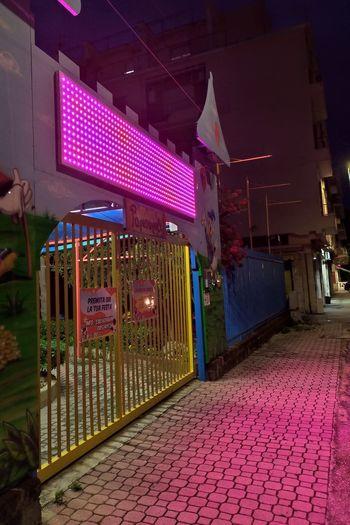 Illuminated night sign Night Nightphotography Neon Illuminated Multi Colored Purple Architecture Sky Lightning Urban Scene Cityscape Residential District Building Residential Structure Office Building Downtown Urban Skyline Forked Lightning