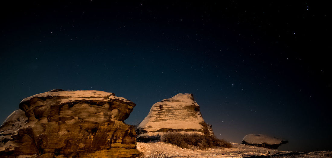 Astronomy Beauty In Nature Clear Sky Desert Galaxy Geology Low Angle View Nature Night No People Outdoors Physical Geography Rock - Object Rock Formation Rock Hoodoo Scenics Sky Star - Space Tranquil Scene Tranquility