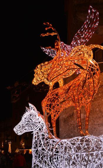 Close-up of illuminated sculpture at night