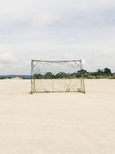 Soccer Goal At Beach Against Sky