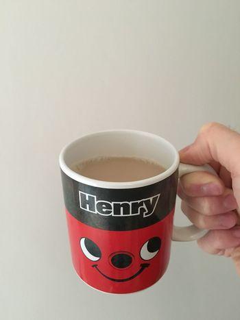 Cup Of Tea Tea Cup Of Joy ⛅☕ Henry Hoover Mug Cup Relaxing Chilling Face Faces Of EyeEm Red Black Hand Fingers Holding Drinking Drink English England Tea Lover Eyes Mouth ... Not Coffee