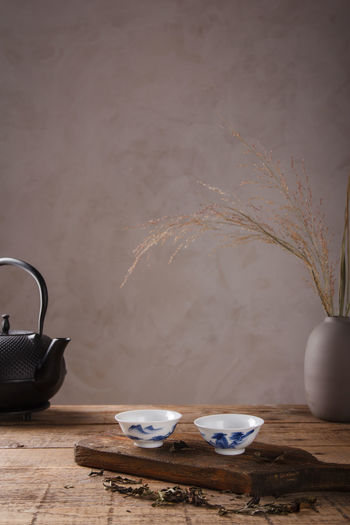 View of tea cup on table against wall
