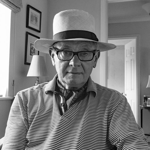Black and White Adult Casual Clothing Clothing Eyeglasses  Front View Glasses Hat Headshot Indoors  Lifestyles Looking At Camera Males  Mature Adult Mature Men Men One Person Portrait Real People Striped