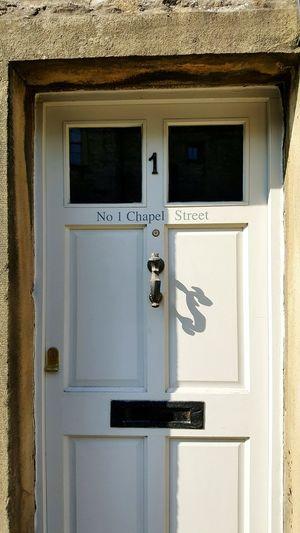 Door detail North Yorkshire Dales Wooden Antique Door Outdoors Close-up No People Painted Door Furniture Brass Door Fittings Door Knocker