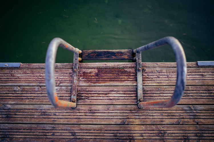 High Angle View Of Rusty Railing On Pier In Sea