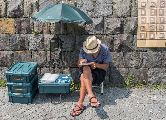 Tourists sightseeing in the street of Otaru City, Japan. Otaru is popular tourist destination and a port city in the island of Hokkaido, Japan. Canal Day Hello World Historic Historical Hokkaido Japan Landmark Otaku People Person Sightseeing Street Tourism Tourist Tourist Attraction  Travel