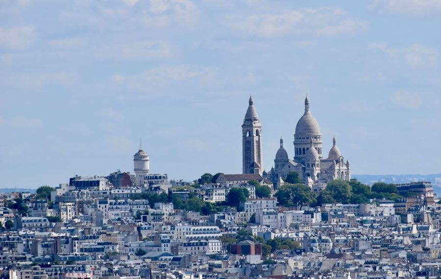 Sacre Coeur as seen from the Eiffel Tower Sacre Coeur Architecture Belief Building Building Exterior Built Structure City Cityscape Dome History Nature No People Outdoors Place Of Worship Religion Residential District Sky Spirituality The Past Tourism Travel Travel Destinations