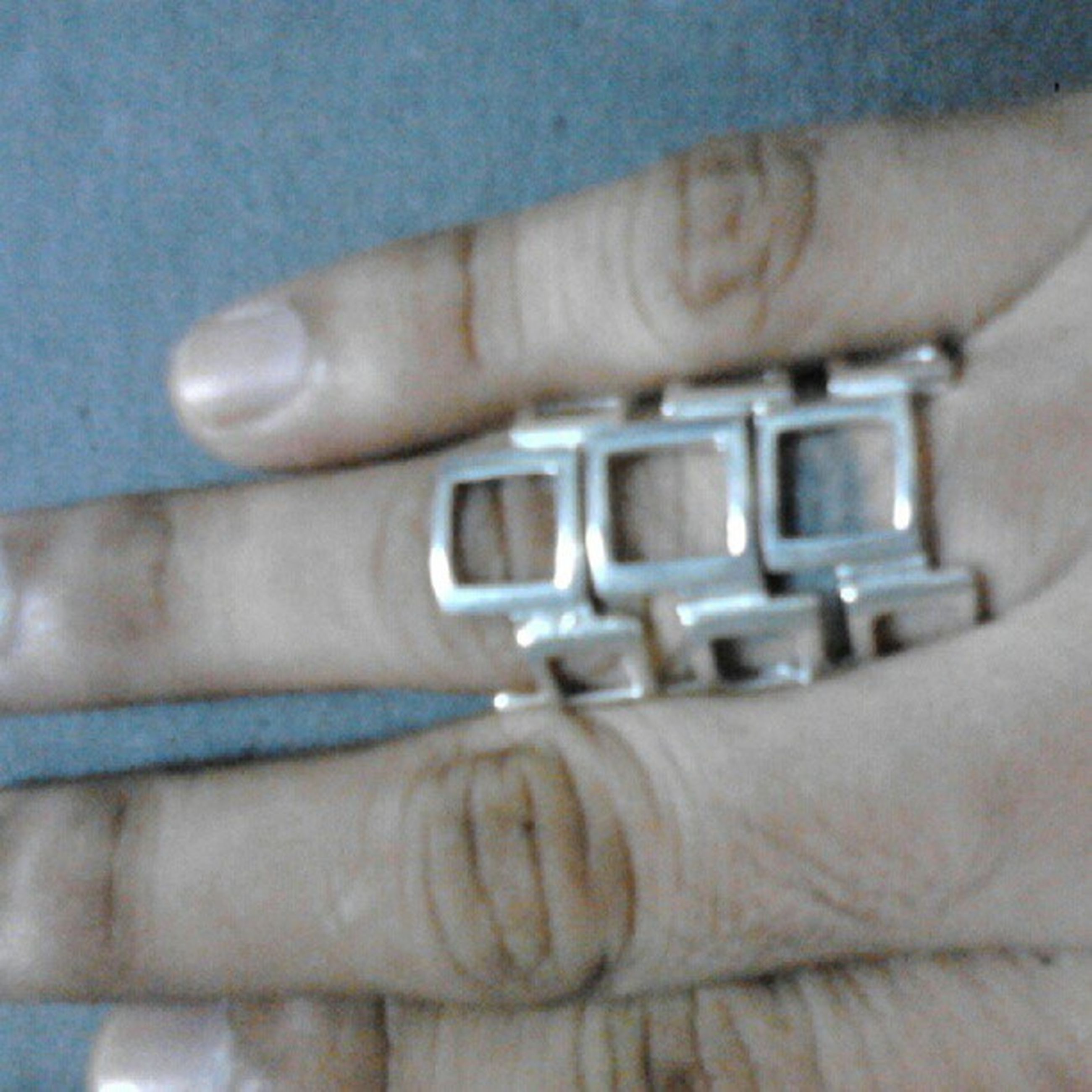 person, part of, indoors, close-up, cropped, human finger, selective focus, focus on foreground, holding, unrecognizable person, metal, men, technology, connection, detail, lifestyles, music