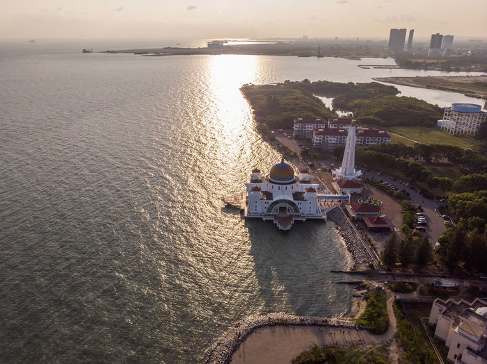 Melaka Straits Mosque, Malaysia Water Architecture Built Structure Sea High Angle View Building Exterior Nature City Sky No People Building Travel Mode Of Transportation Sunset Waterfront Travel Destinations Outdoors Cityscape Melaka Malacca Malaysia ASIA Mosque Melaka Straits Mosque Drone  Droneshot