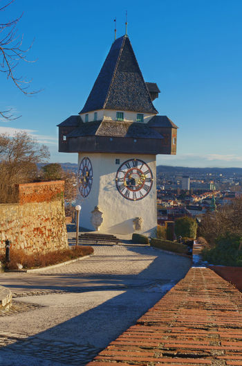 Austria Graz Sightseeing Steiermark,Austria Architecture Belief Building Building Exterior Built Structure Clock Clock Tower Day Nature No People Outdoors Place Of Worship Schlossberg Schlossberg Graz Shadow Sigth Sky Styria Sunlight Tower Österreich