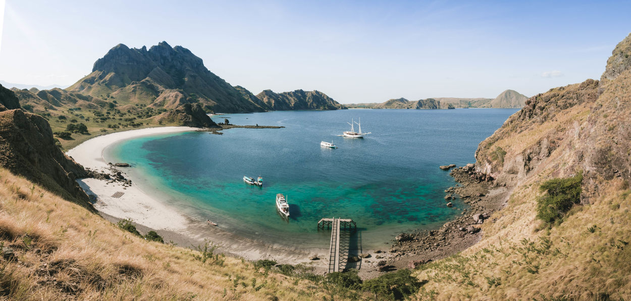 This photo was taken at Padar island at the Komodo national park in Indonesia. The grass was dry at summer time. This landscape is a beautiful tourist destination with blue water and lot of sunshine. ASIA Beach Photography Cliffs INDONESIA Land View Beach Beachphotography Beauty In Nature Blue Cliff Indonesia_photography Komodo Komodo Island Komodo National Park Komodonationalpark Landscape Nature Ocean Outdoors Padar Padar Island Padarisland Sky Tourism