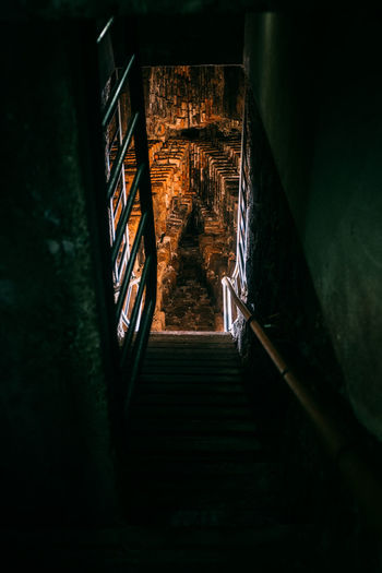 Low angle view of steps in dark building at night