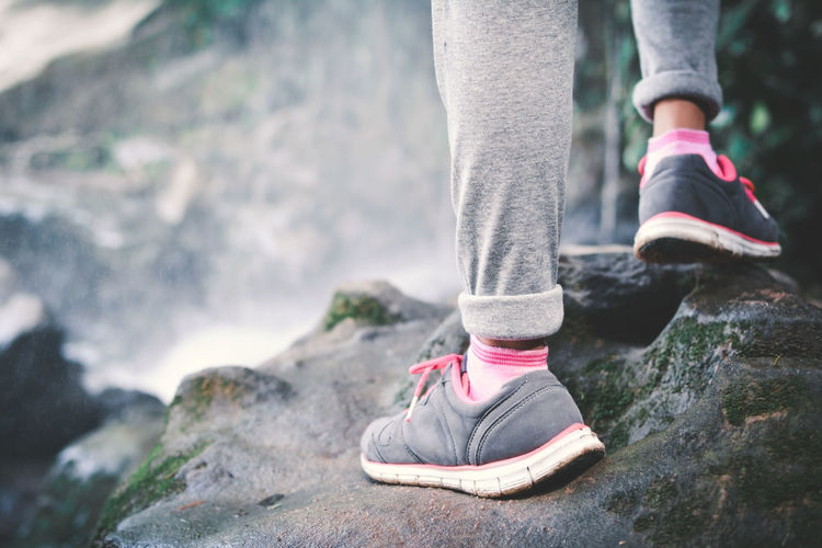 Low Section Of Hiker Standing On Rock