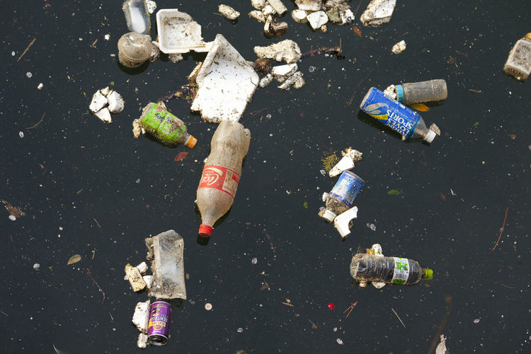 High angle view of garbage on street