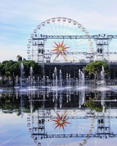 Reflection Ferris Wheel Building Exterior Architecture Built Structure Arts Culture And Entertainment Water Sky Outdoors No People Amusement Park Day Clock Panaromic Low Angle View Travel Destinations Photography Travelling Tourist Attraction  Vacation Holiday Tourist Sculpture Nice France