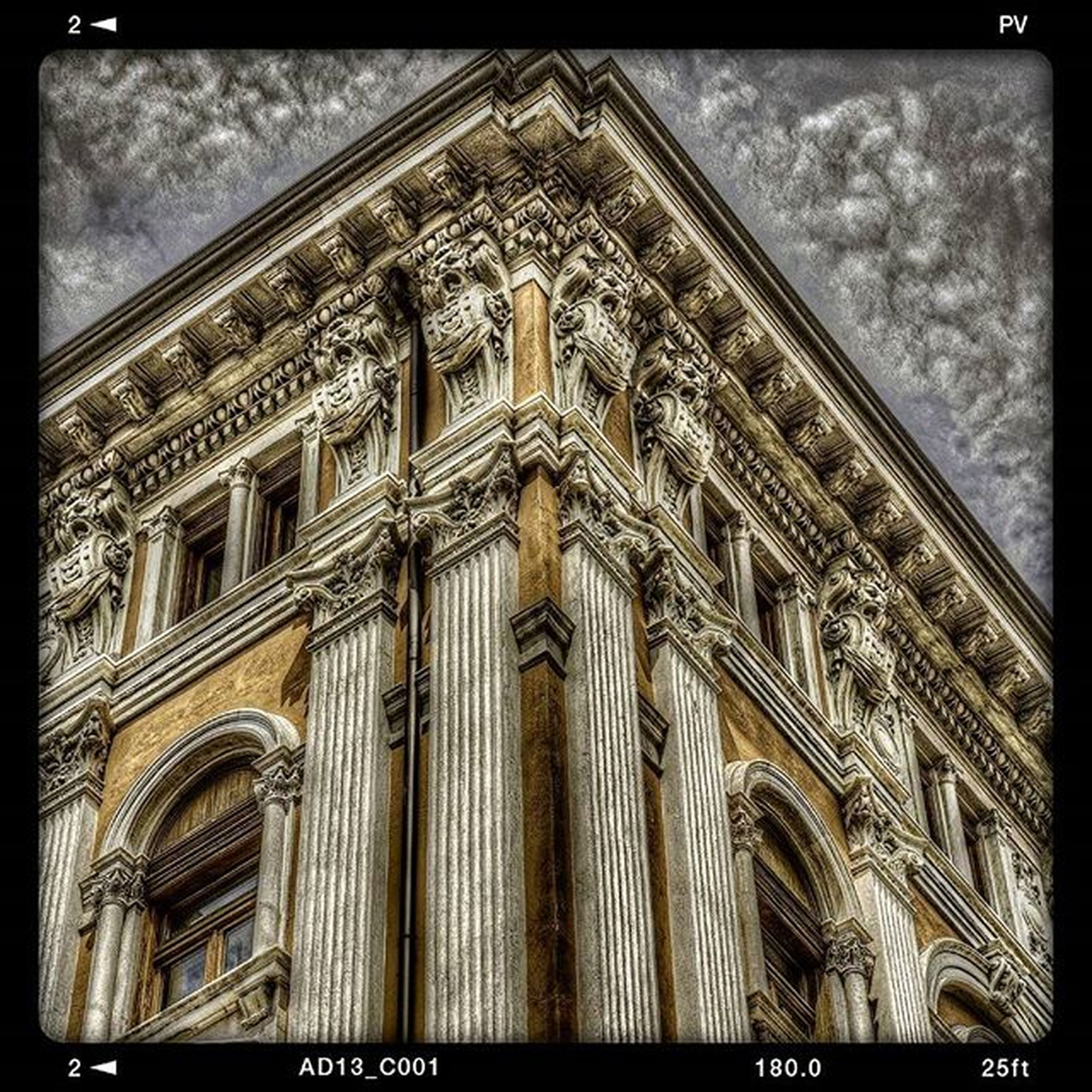 transfer print, architecture, built structure, building exterior, low angle view, auto post production filter, window, facade, history, sky, city, building, no people, ornate, outdoors, day, travel destinations, text, famous place, architectural feature