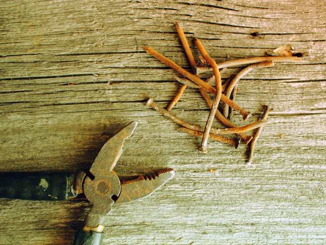 Old rusty pliers and nails on old wooden table background. Old style photo Background Beauty In Nature Boardwalk Brown Day Fragility Freshness Grunge Long Nails No People Old Old Plank Pliers Retro Rustic Rusty Style Table Tranquility Vintage Wood - Material Wooden