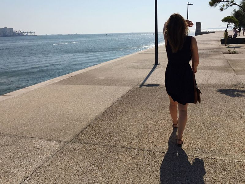 Walking Against The Light At The Sea on Concrete