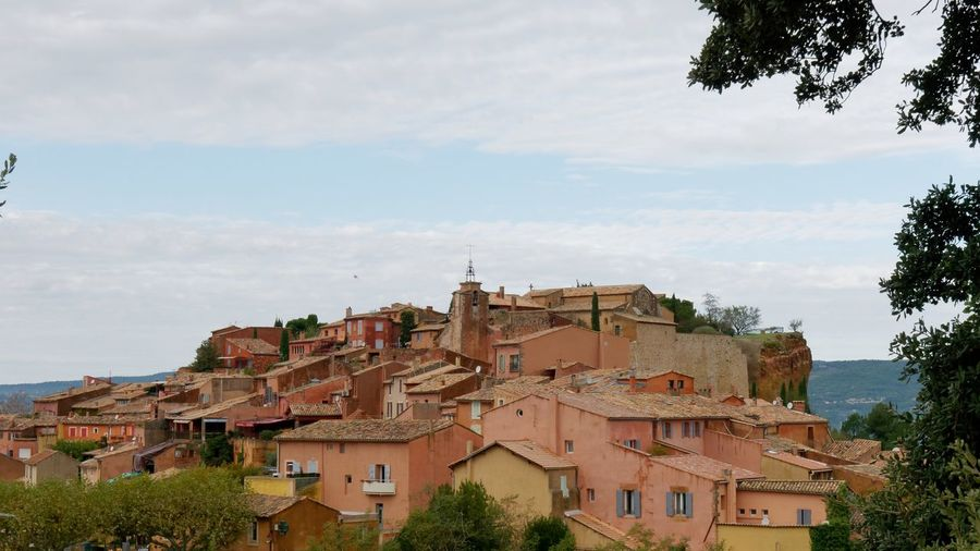 Provence France Ocher Ocher Color Outdoors Cloud - Sky Sky Sky And Clouds Tree Forest Village Village Photography Cityscape TOWNSCAPE Old Town Colorful Colorful Houses Architecture Architecture_collection Façade Building Built Structure City Building Exterior Nature Plant Town Location Place Residential District House No People Exploration Day Roof Travel Journey
