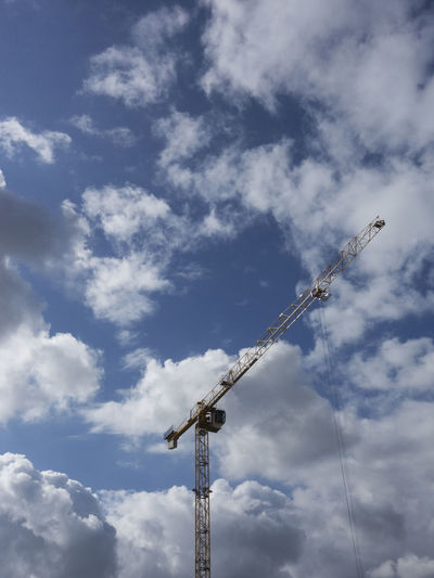 Cloud - Sky Sky Low Angle View Day No People Technology Outdoors Construction Crane Change Urban City Build Work High Clouds Equipment Reniew Architecture Develop Blue Clear Modernization Update
