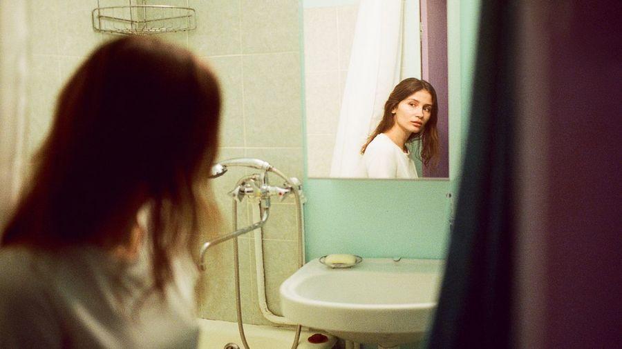 Mid adult woman in bathroom