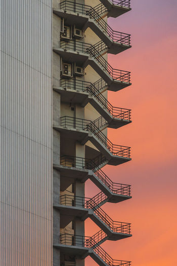 Emergency Exit Of Building Against Sky During Sunset